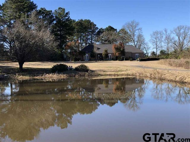 Beautiful Custom Home Just Outside Of Town! Country Feel! 13+ or - Acres To Be Surveyed Out Of 44.757 Acres. A Wonderful View Of The Pond In The Front Of The Home! 3/2.5/2 Lovely Master Suite With Walk In Closet. Large Bathroom With Double Sinks. Hand Scraped Hard Wood Floors And Italian Marble Flooring Throughout Home! Plantation Shutters Thru Out Home. Very Expensive Taste Throughout! Iron Double Front Entry Doors. Fenced In Back Yard. Guest House Needs TLC. Pole Barn With Some Stalls. Graceland Entrance , Concrete Driveway And Circle Driveway. This Is A Must See Home! Reduced TO 359K AS IS. To Much To List