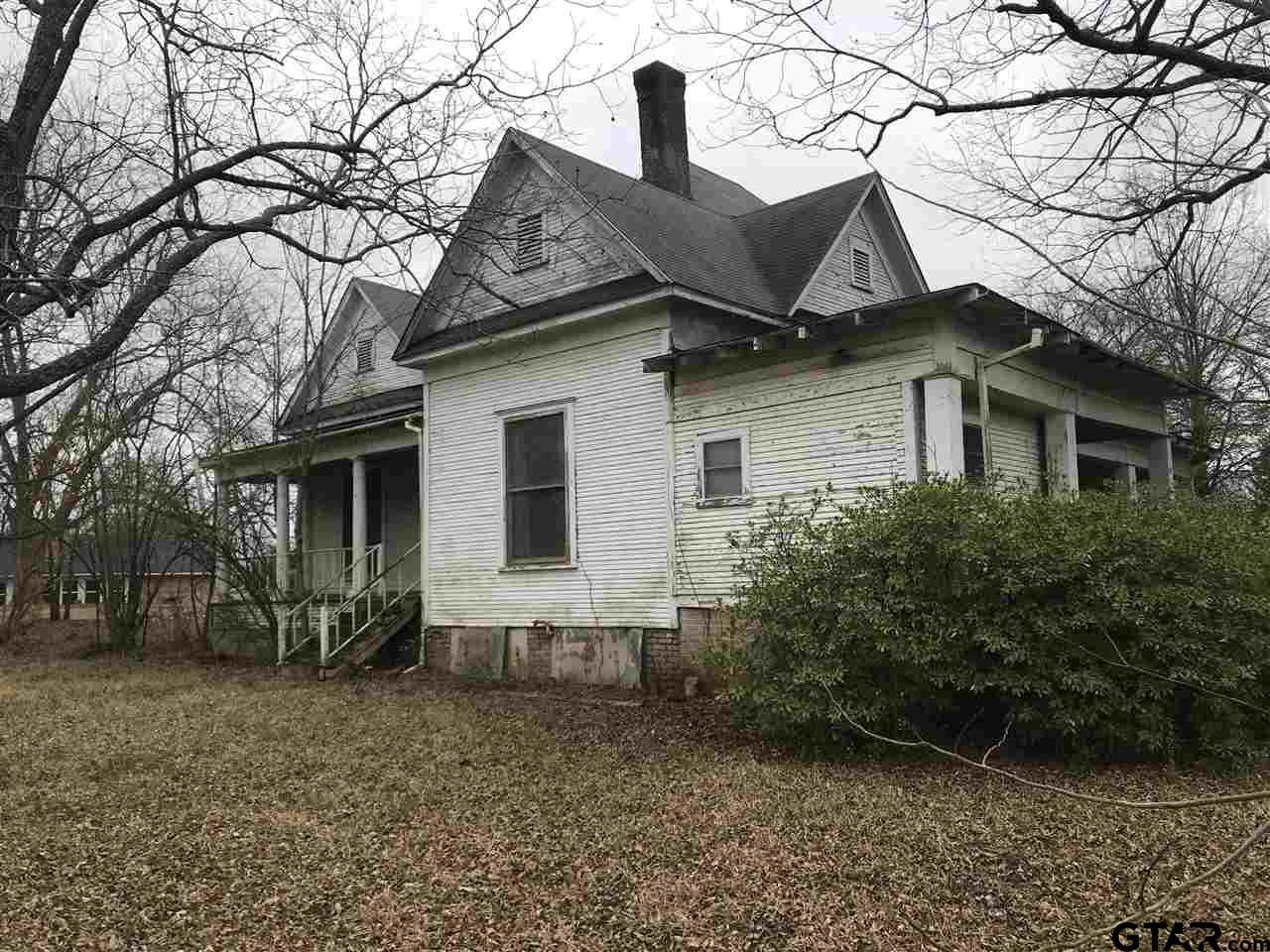 Go back in time with this vintage house built in 1903!  This home feature 3 bedroom and a bonus room upstairs, over 2500 sq ft of living, and sits on a corner lot with 6 extra lots to go with it.  This house is just waiting for someone to bring it back to life!  Call to schedule your showing today!