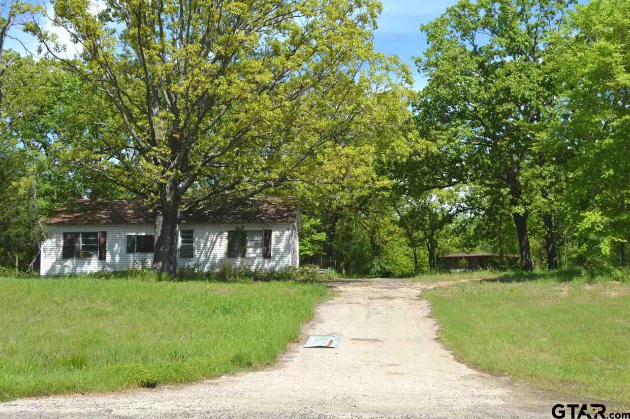 Sitting on 1.7+ acres, and walking distance to World Famous Lake Fork! Home has little to no value, could possibly be a good rehab project if you want to flip this house, or just tear it down and build your own! No Known Restrictions! Seller indicated there is an old septic on the property, but unknown working condition. Located right on Hwy 515, there is tremendous commercial value and exposure here! Enter home at your own risk! Motivated seller says bring all offers! Buyer to verify any and all information.