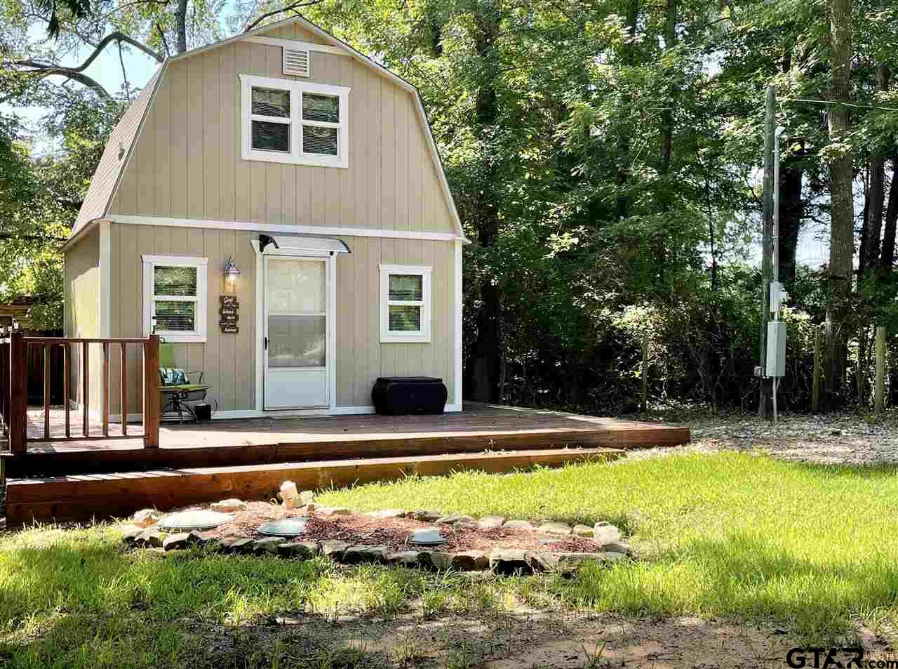 Great investment property to use as a rental for a college student or could be a great starter home. Sitting on 1/2 an acre this two story house features living area and kitchen combo downstairs with spacious bedroom and bathroom upstairs. This beautiful tiny home will be fully furnished and all it needs is you!!