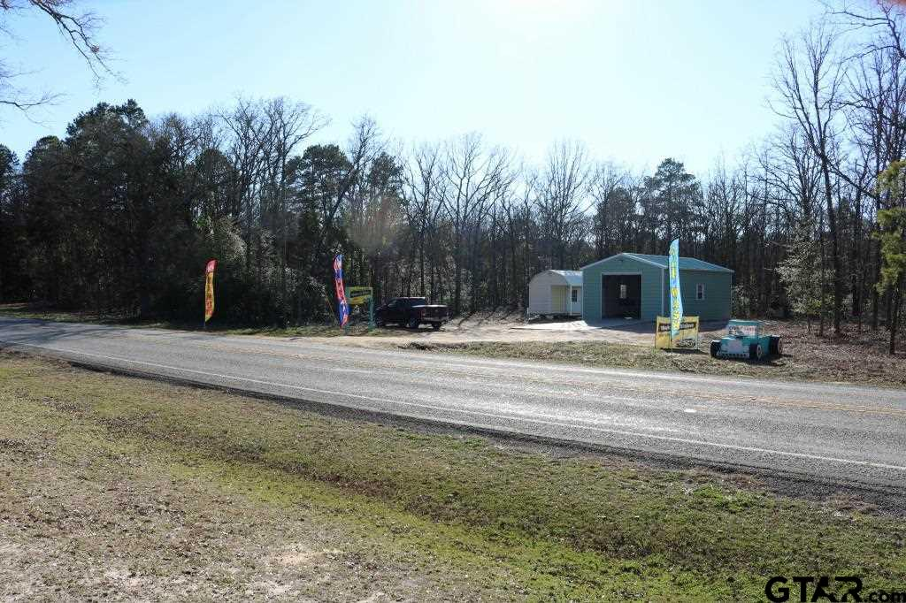 Investment opportunity for Commercial, Residential or combination. Graded entry with electric/water onsite, remaining acreage timber. Gentle downslope from back of buildings to back of property. 120 ft of frontage on highway. TXDOT 2019 traffic count - daily 5,412. Excellent location near Brookhaven Retreat, Holly Lake Ranch and Nestle/Ozarka Waters plant. No zoning with 20'x35' metal building with 10' roll-up door on concrete slab and a 12'x22' portable building.